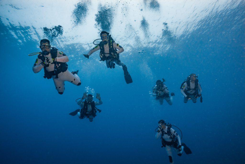 The crew descends to the habitat for splash down