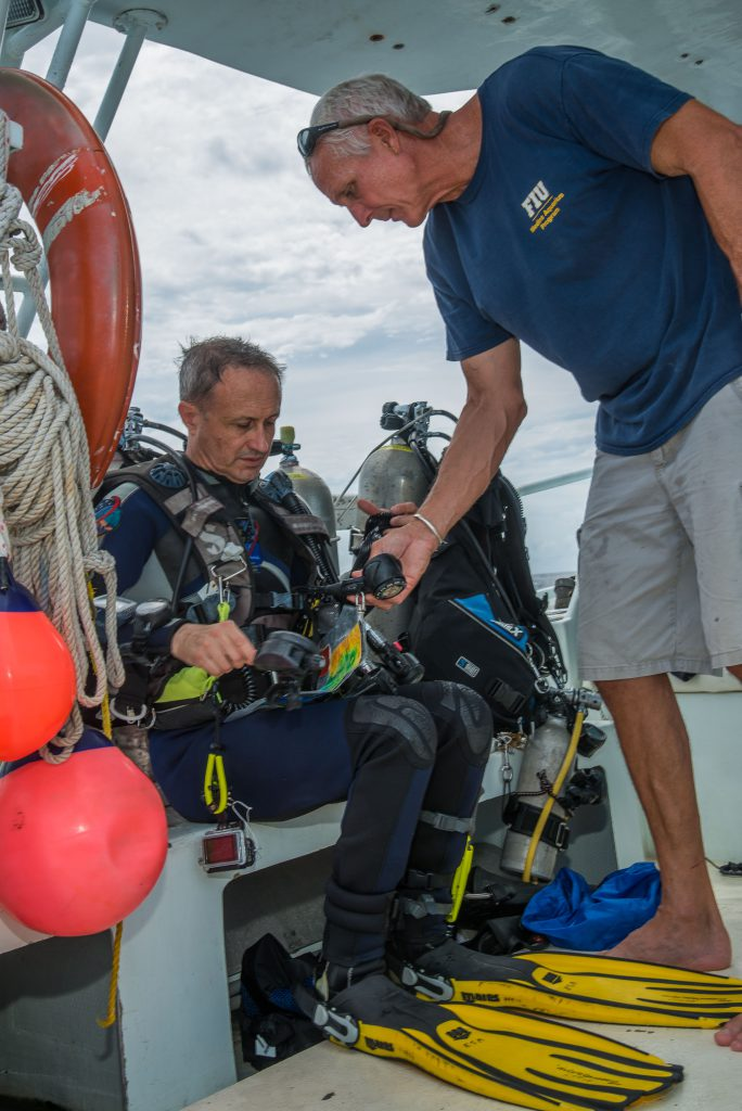 Otto Rutten prepares Herve' Stevenin for a support dive on Aquarius