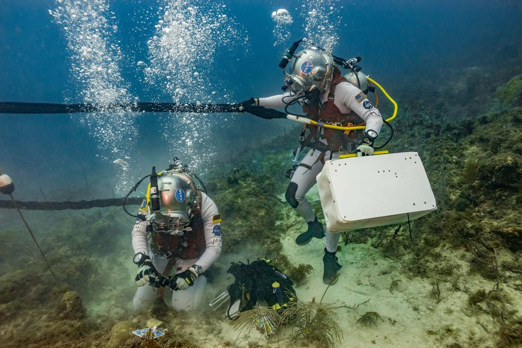 Matthias and Reid working as a team to identify coral and collect PAM data
